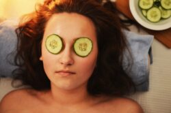 picture of woman relaxing with cucumber slices covering eyes