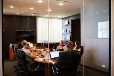 young adult in office board room