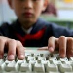 young student typing